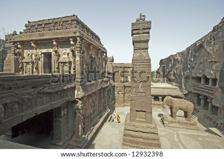 Stone carved elephant and obelisk outside the ancient Hindu Temple (Kailas Temple) carved out of solid rock. Cave number 16, Ellora Caves, near Aurangabad, India. 8th Century AD
