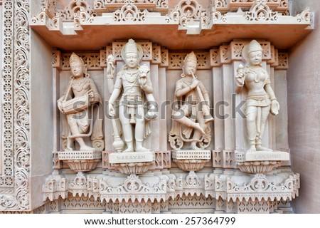 Stone carved erotic bas relief in Hindu temple at BAPS Shri Swaminarayan Mandir - stock photo