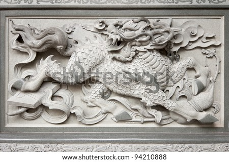 Stone Carving of Qilin on Chinese Temple Wall in Chinatown - stock photo