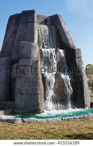 stone cascade artificial waterfall in Croatia - stock photo