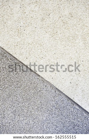 Stone cement wall, detail of a concrete wall decorated with small stones - stock photo