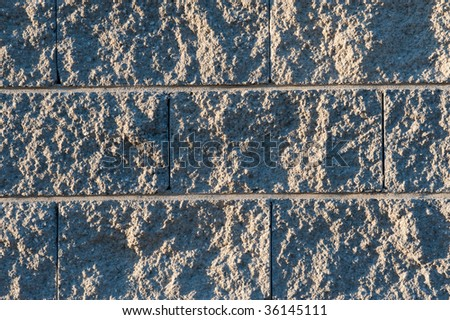 Stone cement wall texture at morning light - stock photo