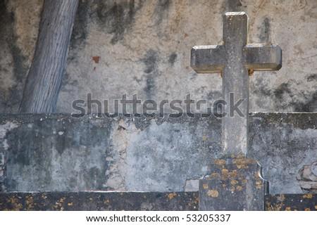 stone cemetery cross - stock photo