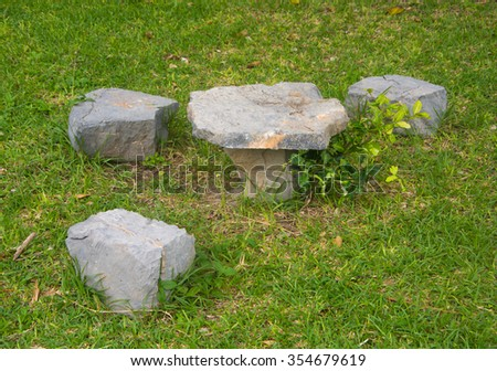STONE-CHAIR ON THE YARD FOR RELAX-SITTING  - stock photo