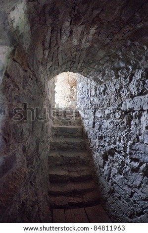 stone corridors in the ruins of an ancient castle - stock photo
