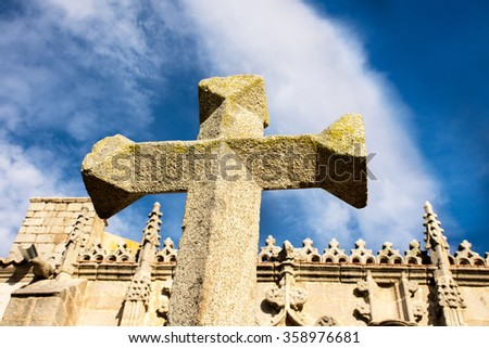 Stone cross on blue sky from middle age - stock photo