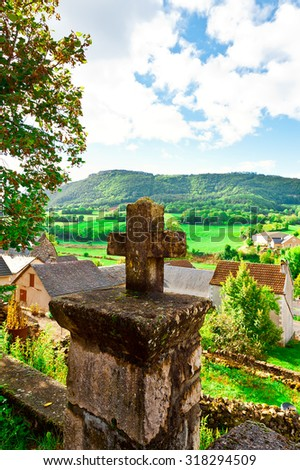 Stone Cross on the Background of the French Town - stock photo