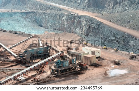stone crusher in a surface mine. Open pit mine. Quarry - stock photo
