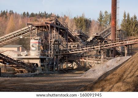 Stone crushing line for gravel production - stock photo