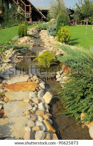 stone decorative pond at the backyard - stock photo