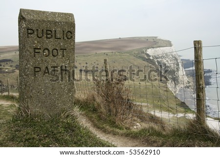 stone engraved public foot path sign on coastal path along the white cliffs of dover in kent england - stock photo