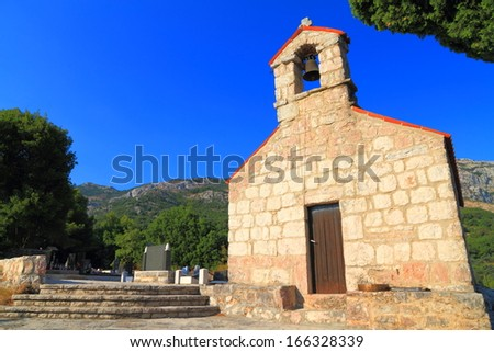 Stone facade of traditional orthodox monastery near the Mediterranean sea - stock photo