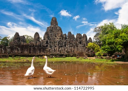 Stone Faces on a Bayon, siem reap, Cambodia, was inscribed on the UNESCO World Heritage List in 1992. - stock photo