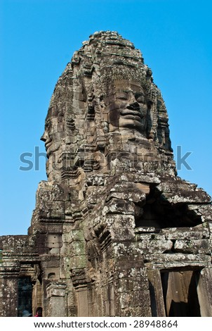 stone faces on towers of Bayon temple in Angkor Thom, Cambodia