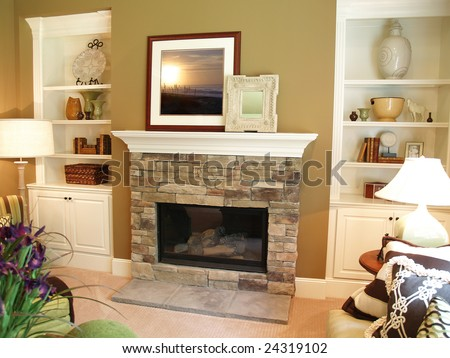 Stone fireplace in a modern living room with a white painted wooden mantle. Artwork has been replaced with art that I own the copyright to. - stock photo