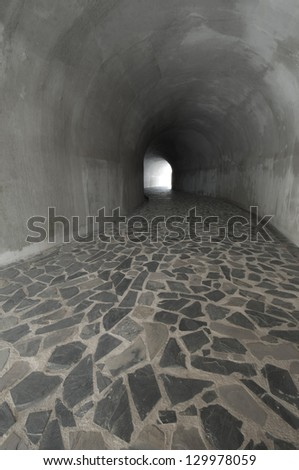 Stone floor tunnel - stock photo