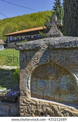 Stone fountain and church in  Temski monastery St. George, Pirot Region, Republic of Serbia - stock photo