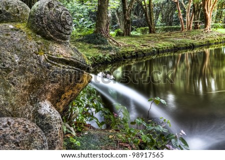 Stone frog fountain with pond and forest (HDR) - stock photo