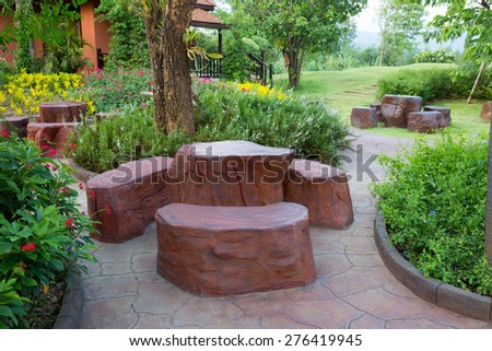 Stone Garden Table and three chairs.  - stock photo