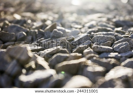 Stone gravel during sunny day - stock photo