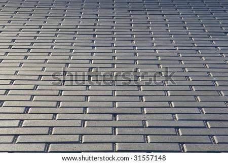 Stone gray block paving background - stock photo