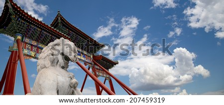 Stone Guardian Lion Statue in Beihai Park -- is an imperial garden to the northwest of the Forbidden City in Beijing, China - stock photo