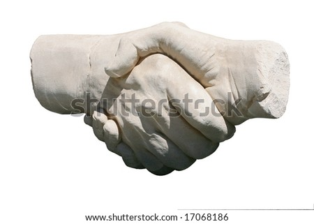 stone handshake sculpture isolated on white background