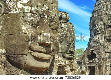 Stone head on towers of Bayon temple in Angkor Thom, Cambodia - stock photo