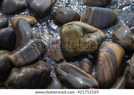 stone heart on other stones - stock photo