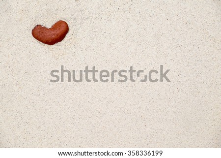 stone hearts in sand.(selective focus) - stock photo