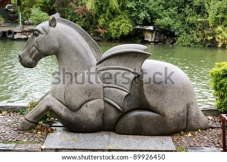stone horse with wing - stock photo