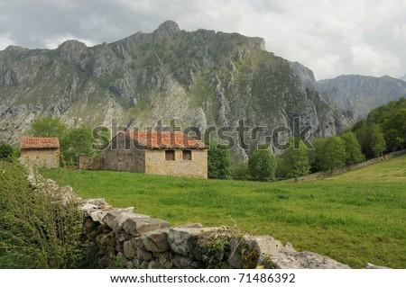 Stone houses in the mountains (Picos de Europa) - stock photo
