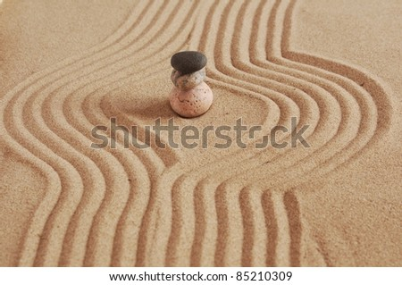 stone in circles on a sand background