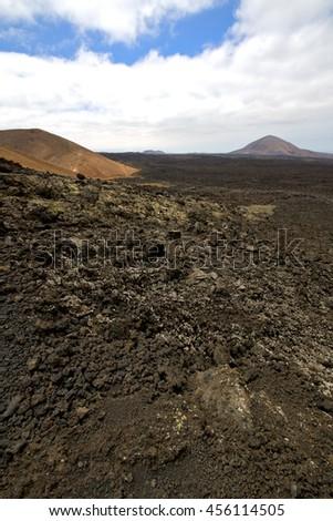 stone in los volcanes lanzarote  spain volcanic timanfaya  rock  sky  hill and summer  - stock photo
