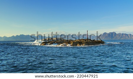 Stone in Norwegian sea - stock photo