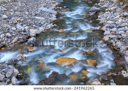 stone in river - stock photo