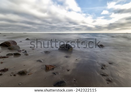 Stone in the water on the coast of Baltic Sea in Poland