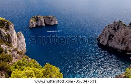 Stone islands and sea on Capri coast - Italy - stock photo