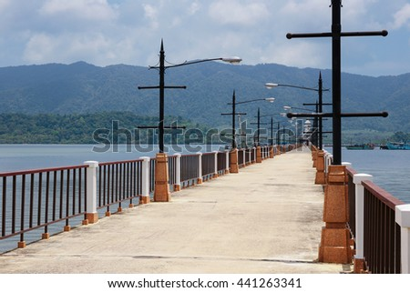 Stone jetty on exotic beach of a tropical island Koh Chang,Thailand - stock photo