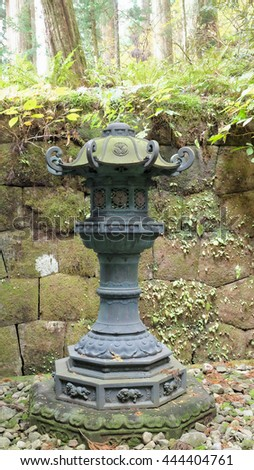 Stone lamp in the garden - stock photo