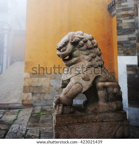 Stone lion in chinese temple - stock photo
