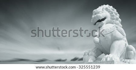Stone Lion sculpture, symbol of protection in China - stock photo