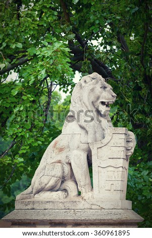 Stone lion with a board in paws near the Vajdahunyad lock in Budapest - stock photo