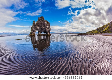 "Stone ""mammoth"" Iceland. The picturesque cliff in Bay of Hoonah during low tide at sunset - stock photo"