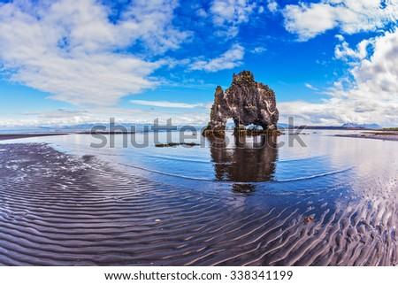 """Stone """"mammoth"""" Iceland. The picturesque cliff in Bay of Hoonah. Hvitserkur rocks during low tide at sunset - stock photo"""