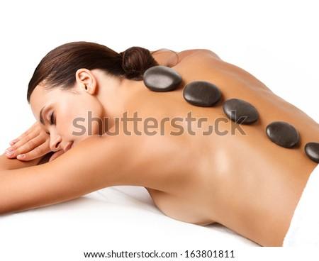 Stone Massage. Beautiful Woman Getting Spa Hot Stones Massage  - stock photo