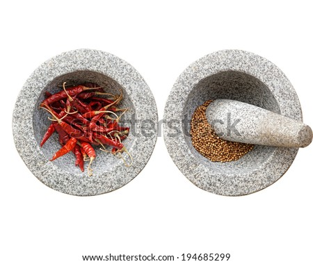stone mortar and pestle, with chili and peppercorn inside. - stock photo