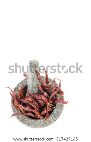 stone mortar and pestle with dry chilies on white background - stock photo
