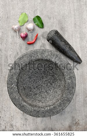 Stone mortar with many kind of herbs in kitchen - stock photo