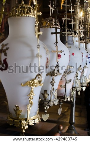 Stone of Anointing lamps in Holy Sepulchre Church in Jerusalem.  - stock photo